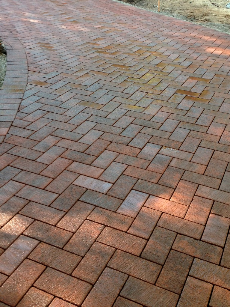 dark terra cotta bricks in a chevron pattern