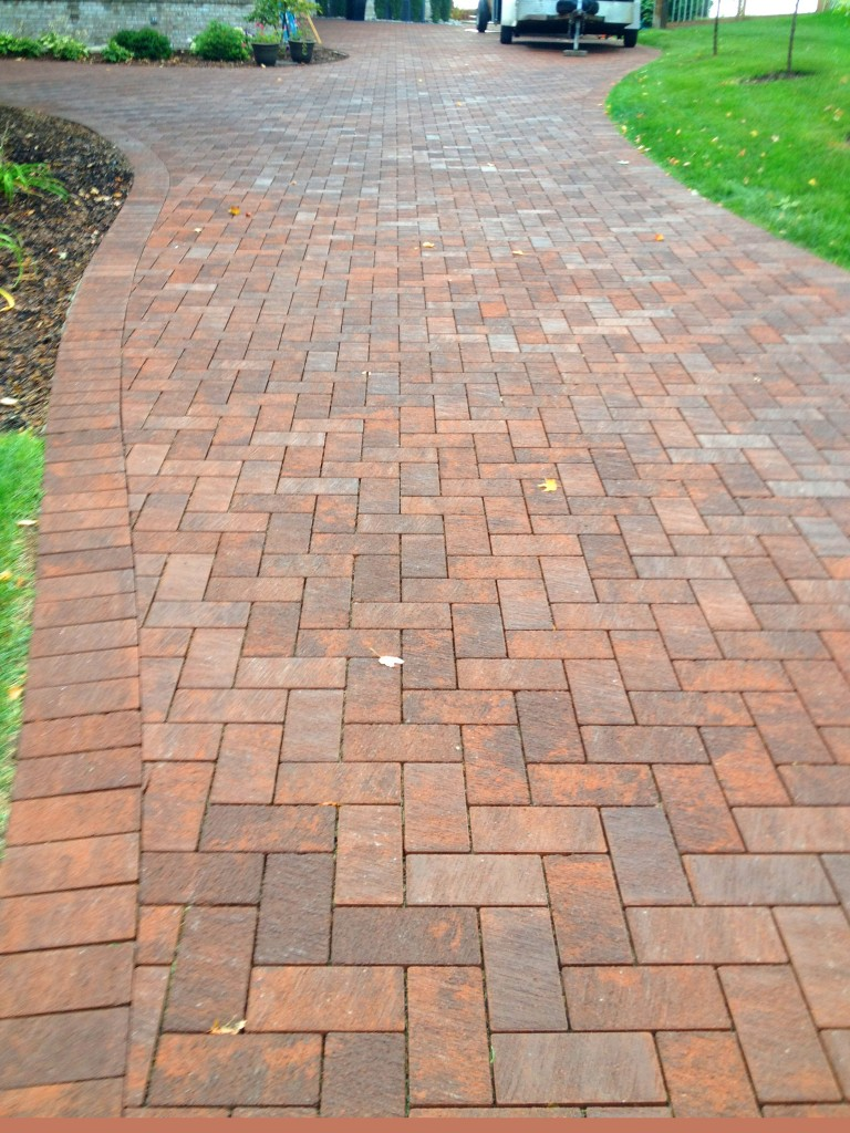 bricked pathway leading to garage