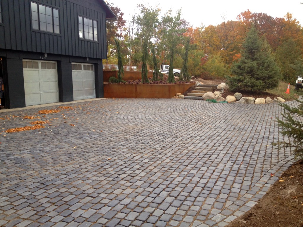 gray stone paved driveway with autumn leaves