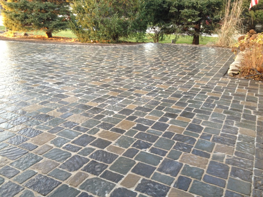 multi color smooth pavers outside of residential home