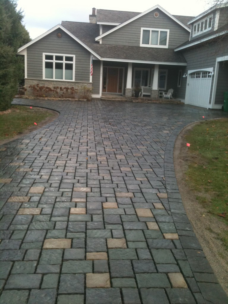 smooth square paver driveway to front of home