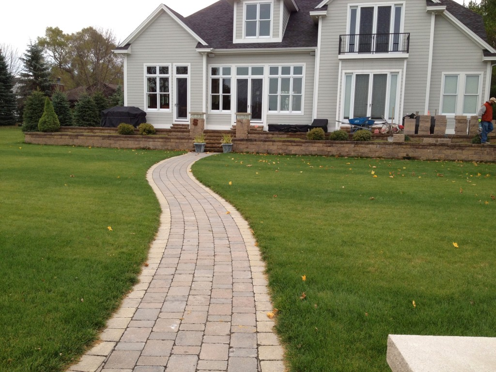 brick pathway to back entrance of home