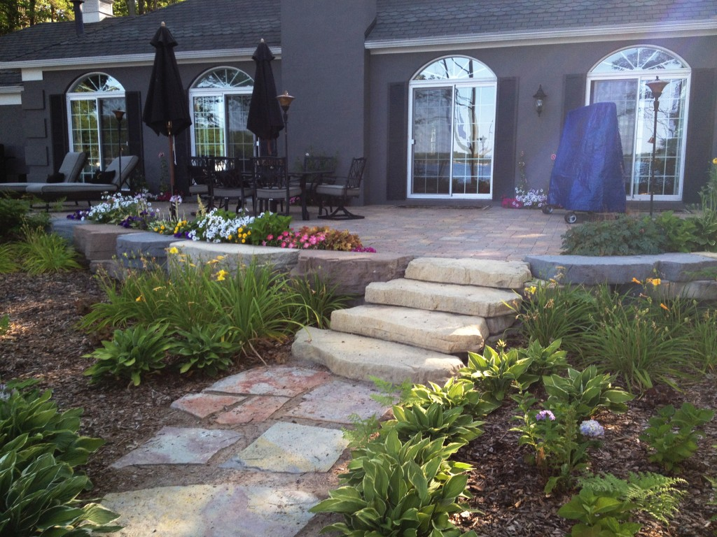 large flat stone walkway to patio stairs