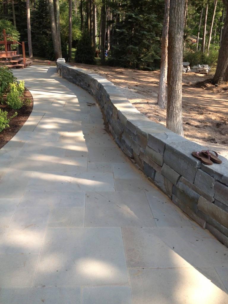 smooth sidewalk in wooded area
