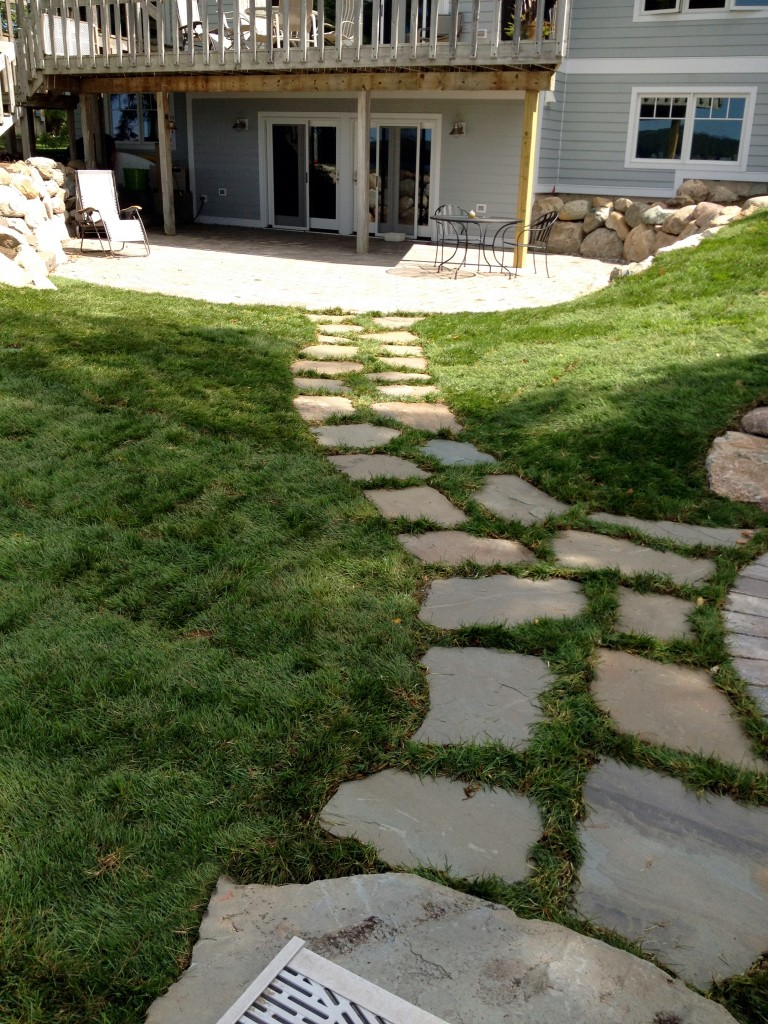 inlayed rock path leading to basement door