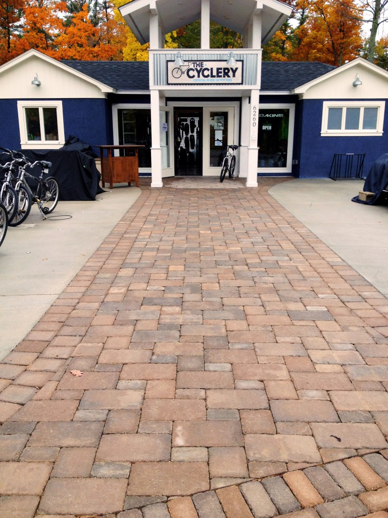 brick sidewalk outside of the cyclery