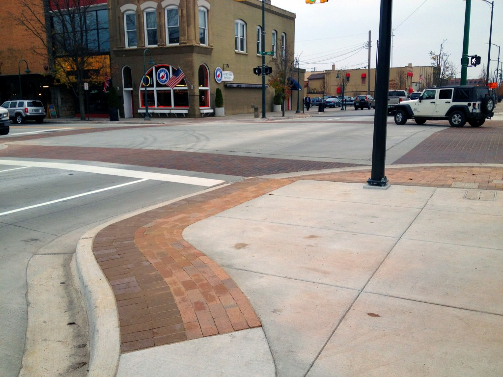 brick sidewalk corner at W. State and S. Union street