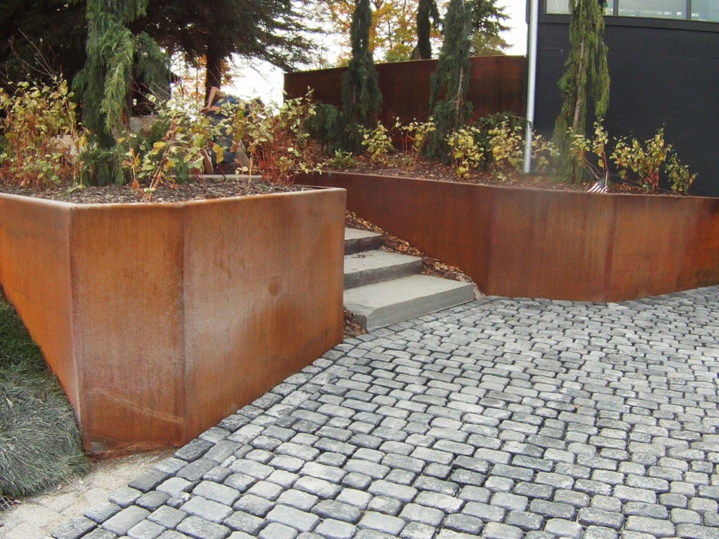 decorative shrubs on retaining wall garden