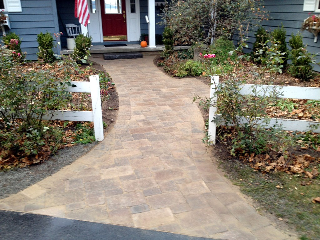 pathway to front door with white fence accents