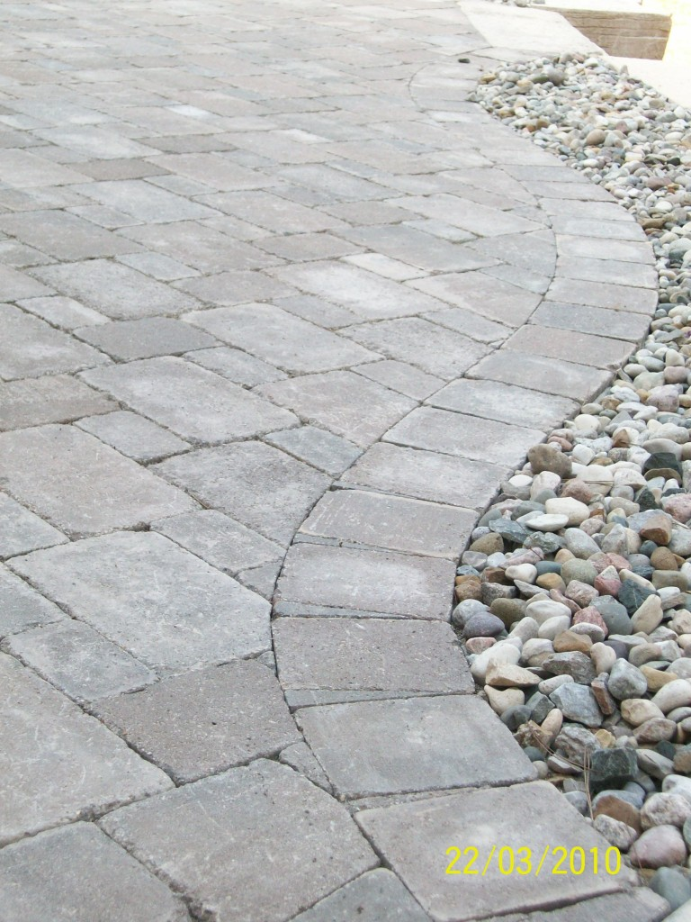 paver walkway with small rock accents