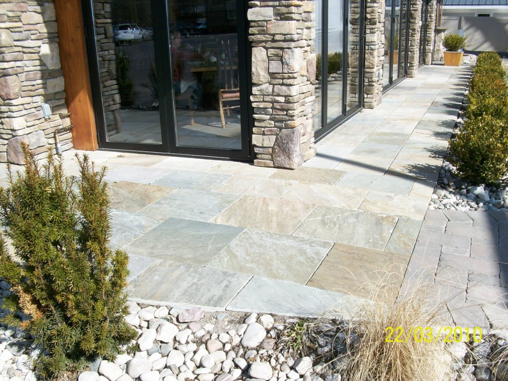smooth flag stone paths with rock column pillar building facade