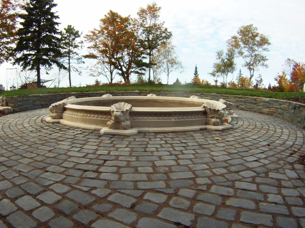 pavers encircling decorative fountain