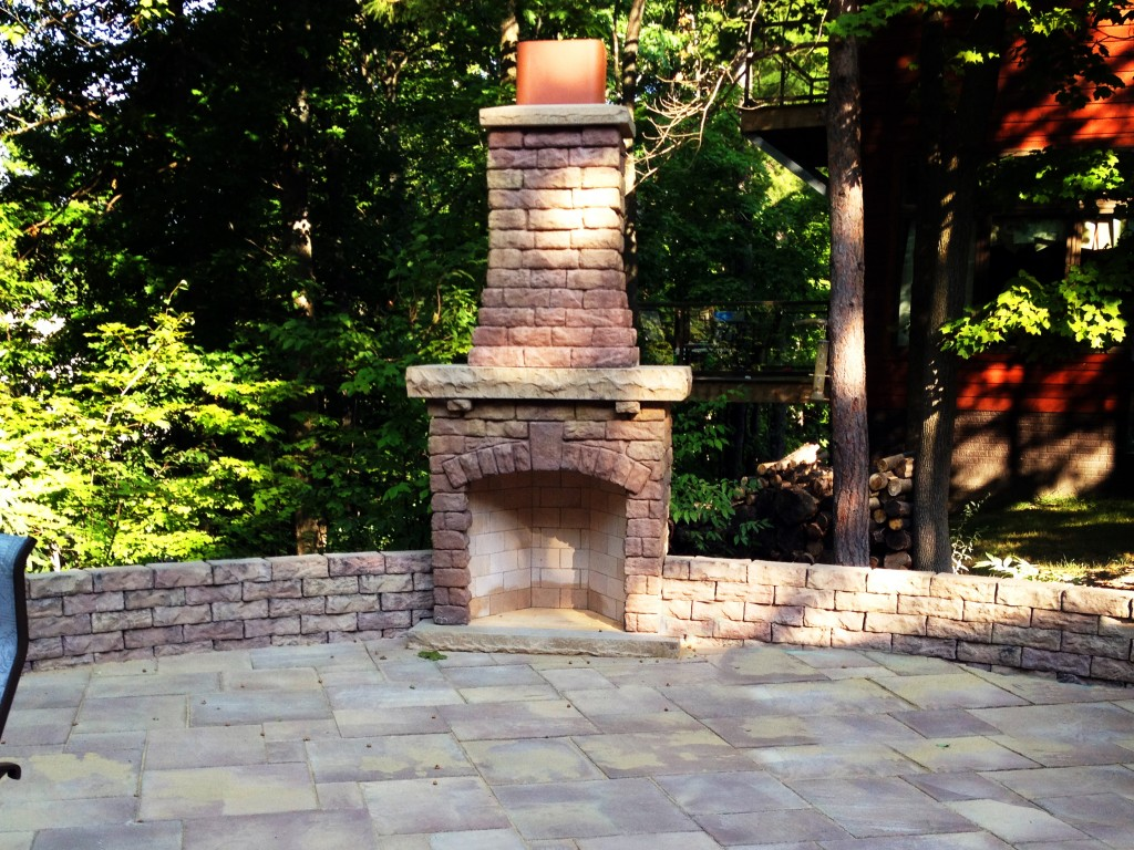 outdoor brick fireplace on patio