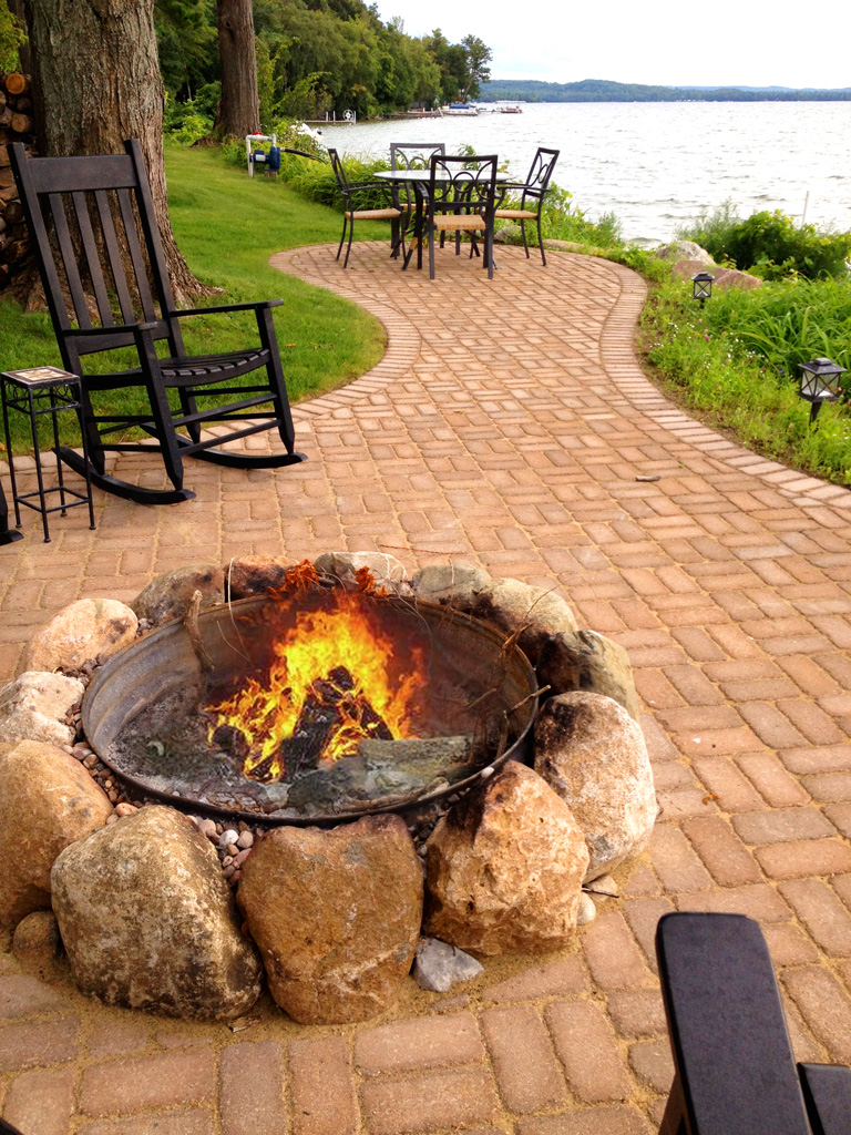 large stones encircle outdoor fire pit