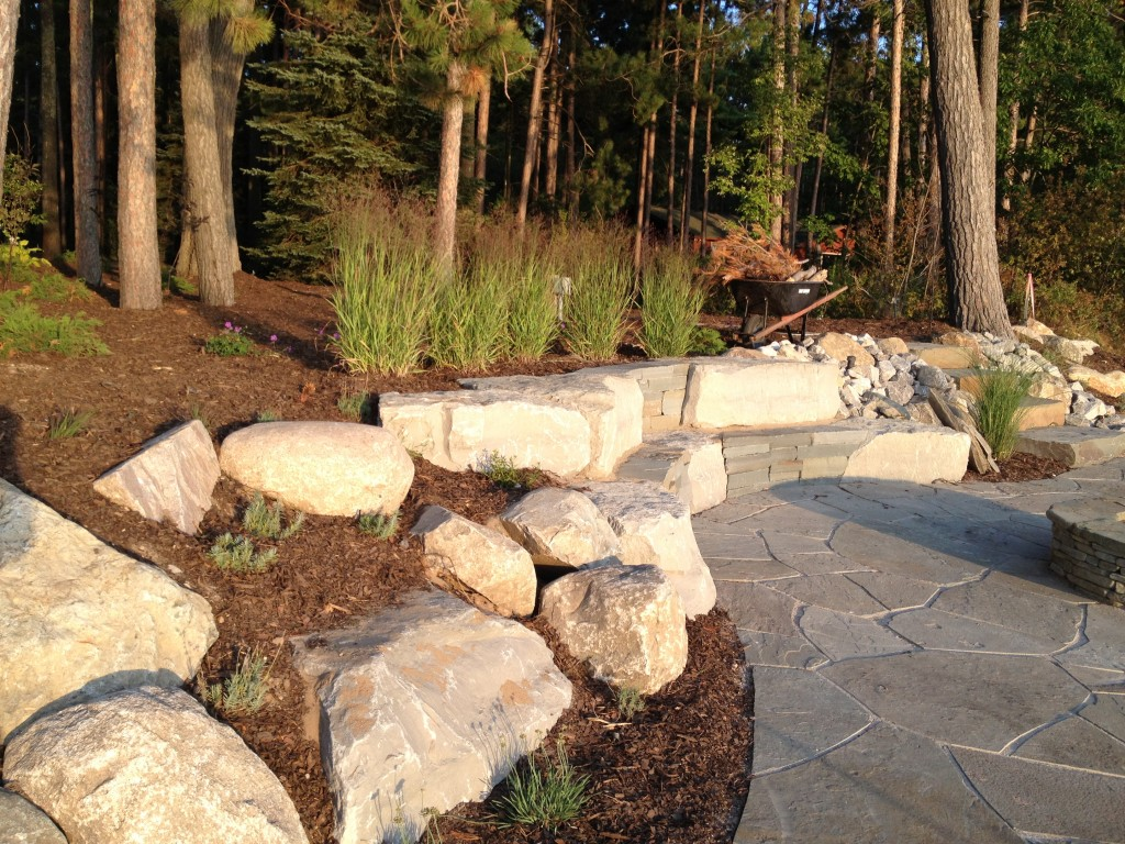 large stones and mulch in landscape design