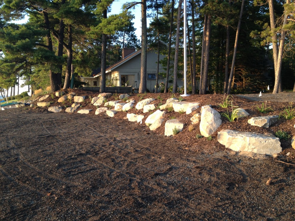 stone and mulch barrier