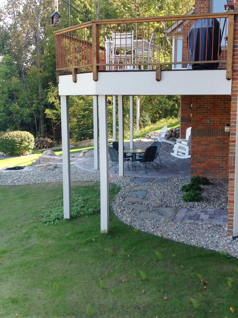 landscaped area with small rocks under deck