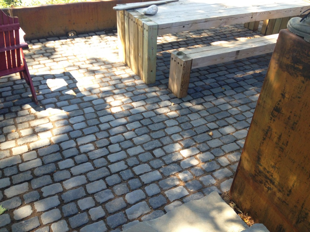 darkly colored paving stones used in outdoor space