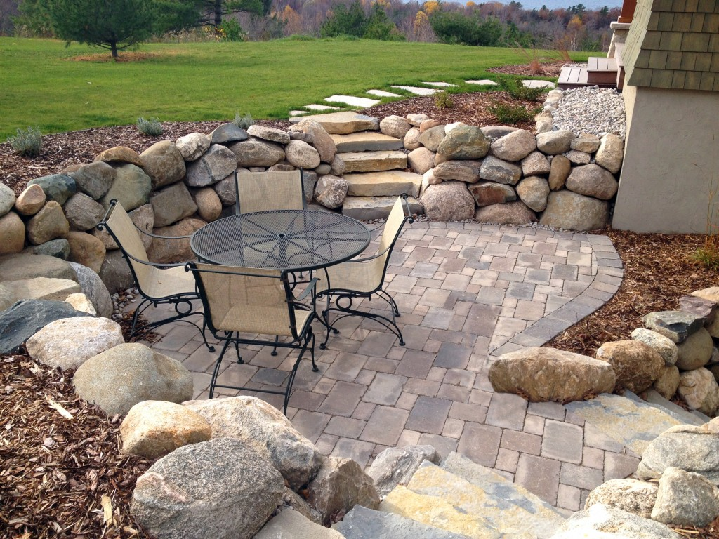 retaining wall of large stones with mulch topper