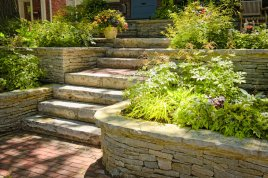 retaining wall with large stone steps