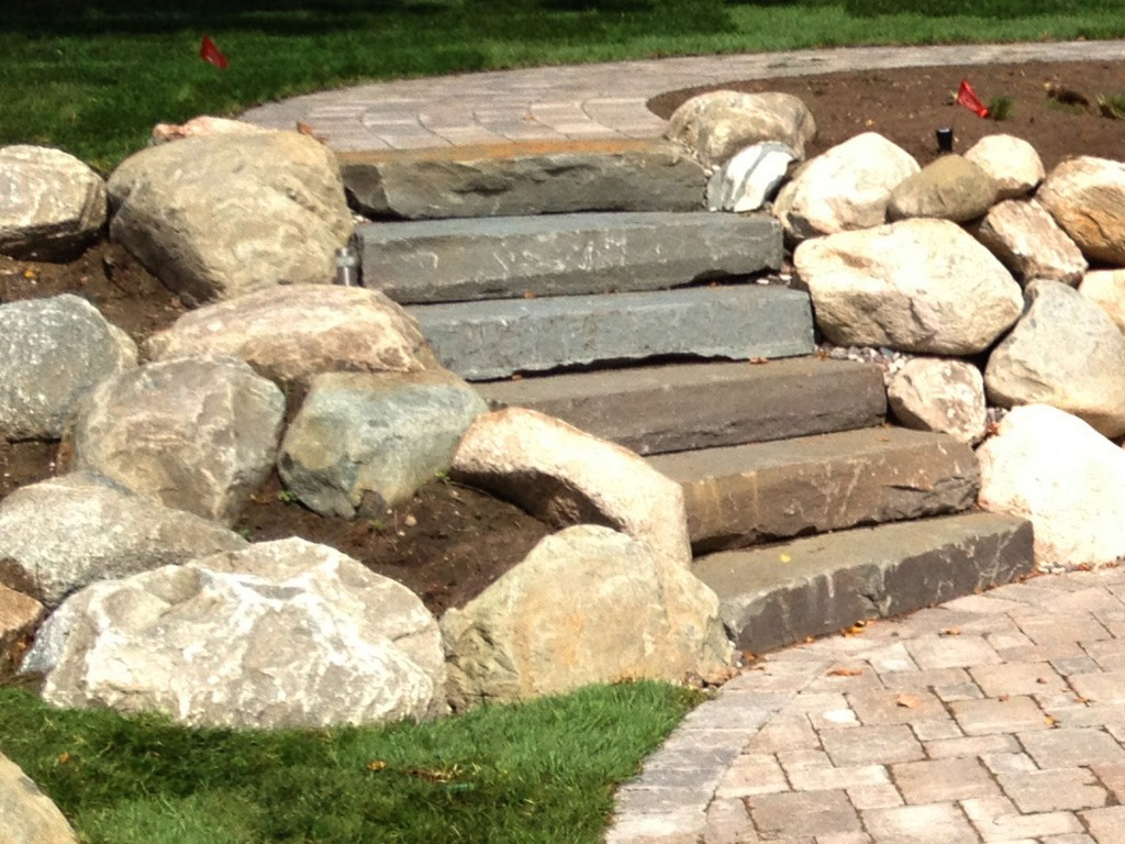 stone stairs with large rock accents, with custom brick paver walkway.