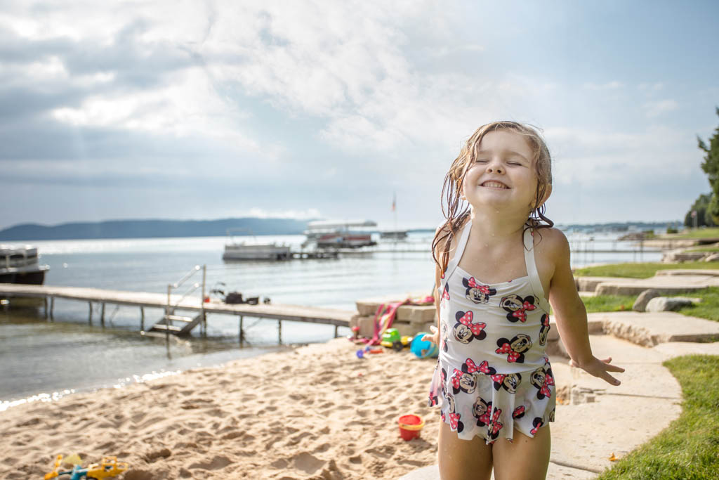 young child having fun at the beach