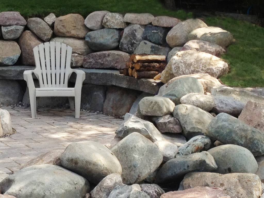 white plastic lawn chair on stone patio