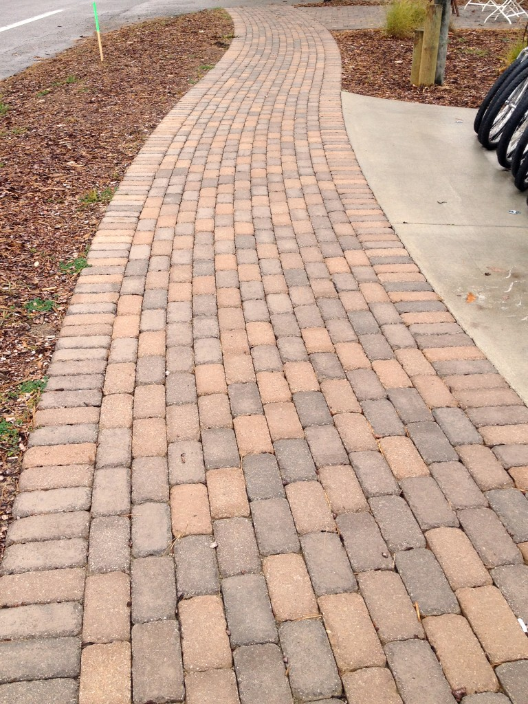 walkway with light red brick pavers